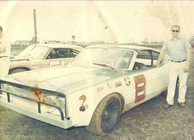 I bought this photo from a vendor at the Sterling Speed Bowl in Sterling, Illinois in 1970. This was the first year Darrell raced Ford Torinos. I thought this was a beautiful stock car for its time. Note the glass windshield and windshield wiper. That's Roger Dolan pitted next to Darrell.
