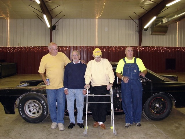 "In 2007, a ""Legends"" night was held at the Farley Speedway to honor Darrell Dake. Pictured are members of Darrell's pit crew - left to right Marv, Hubbard, Darrell and Page Lemon. (Kenny Walton photo collection)"