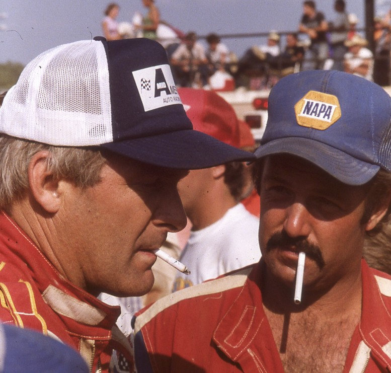 Two of the best share a smoke at the World 100, Larry Moore and Jack Boggs.