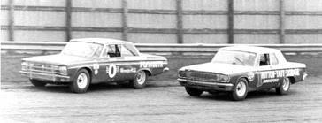 Ramo Stott #0 racing his nemesis Ernie Derr.