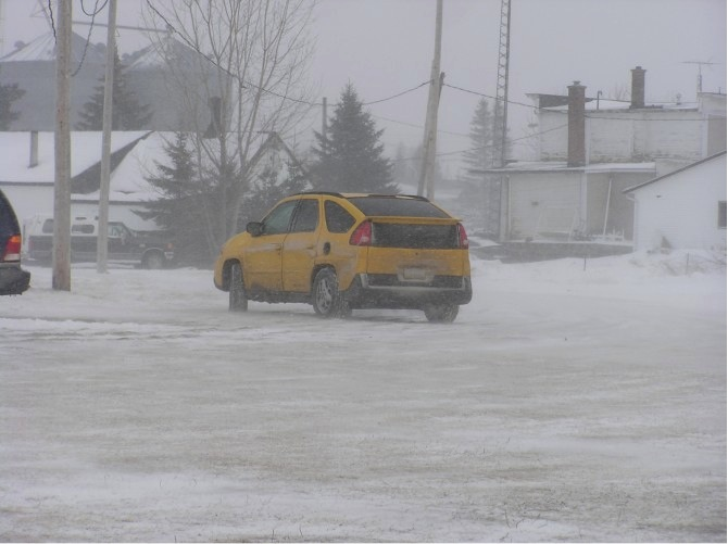 Ice racing viewing conditions can be rough.  This was the only car I saw leaving the track early today at intermission.