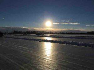roy's lake ice racing into the sun