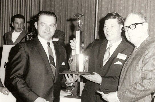 This has to be a rare photo. Here Darrell receives his trophy from co-promoter Johnny Beauchamp. This is believed to be in Des Moines. Johnny Beauchamp was famous for running second to Lee Petty in the very first Daytona 500. Johnny also returned to the local dirt track racing wars. He won two consecutive championship point titles at the Peoria Speedway driving a 1955 Chevy sponsored by Al Baker's Kartville. (Bob Dixon collection)