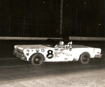 I'm just guessing but I think Darrell used one car for 3-4 years. This looks like the last remnants of the car he built in 1966. Here Darrell takes the feature checkered flag at Des Moines in 1969.