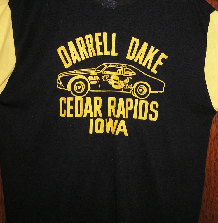 In all my years of cheering for Darrell Dake, I only saw two different t-shirts with his name on it. The first one was out of print and I bought the other one pictured here. I don't know why he had them made in yellow and black, because I never him saw him race a car with those colors.