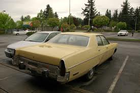 My Plymouth company car was dark blue. The trunk was big enough to camp in all summer!