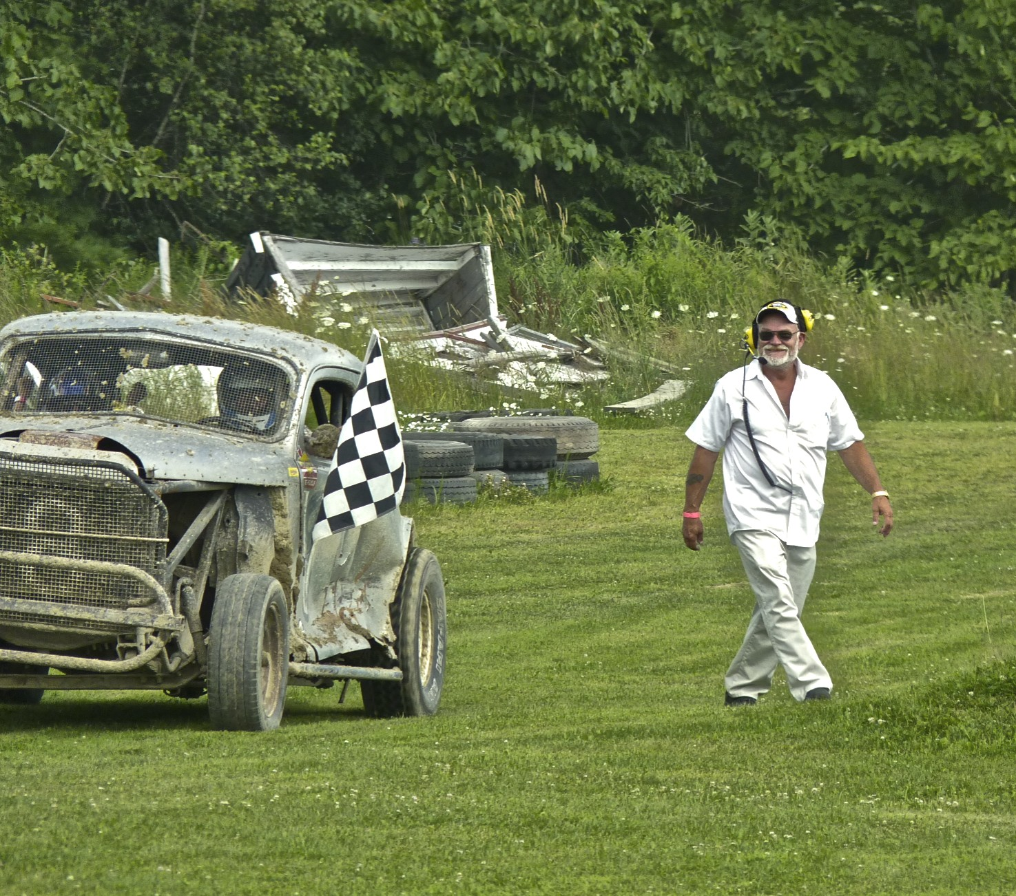 """""""Hutch"""" hands out another checkered flag."""