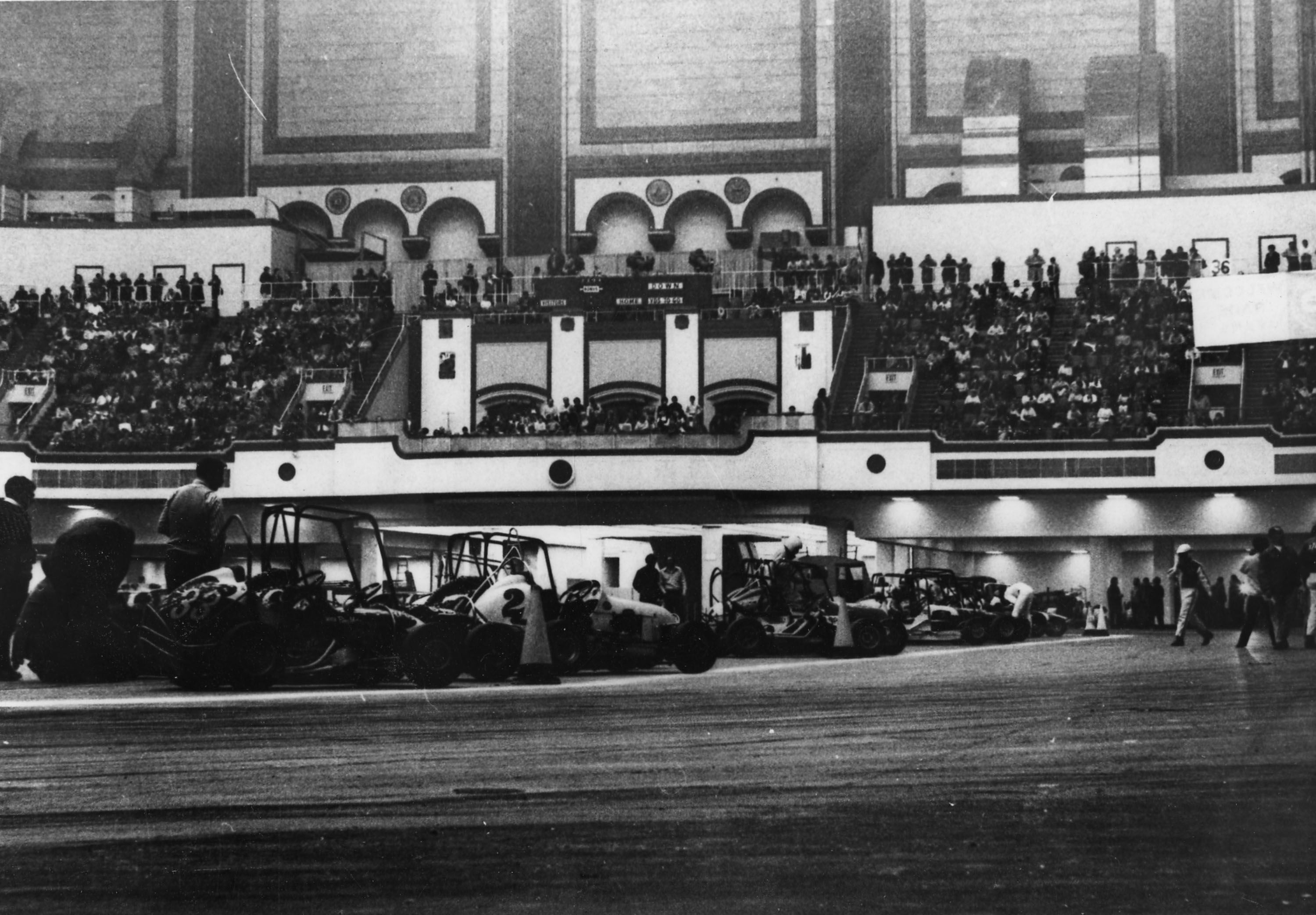 The floor of Convention Hall (1970 photo) accommodated a full 1/5 mile concrete oval plus the entire pit area through the 1981 season. All the fans found stadium seating in the balcony. Lighting on the track was perfect and the famous Convention Hall pipe organ played during breaks in the racing action. Today's indoor track is about half the original size. Source: EARHS