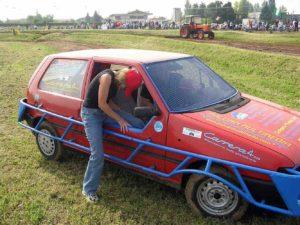 carol hopping in italian race car