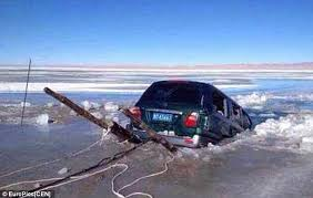 car falling through ice
