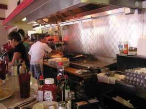 I love to watch these places cook the food.