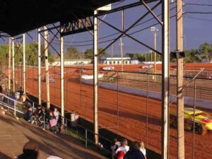 The track surface is a bright red Oklahoma clay.