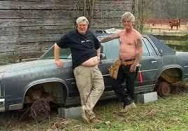 beat up car with guys