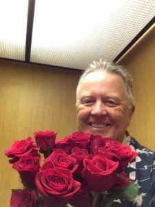 randy with roses