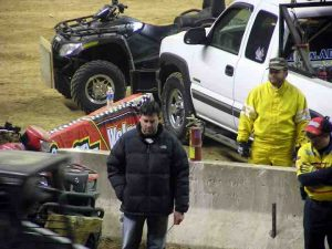 Tony Stewart supervises the track prep.