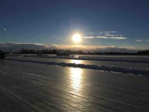 roy's lake ice racing into the sun