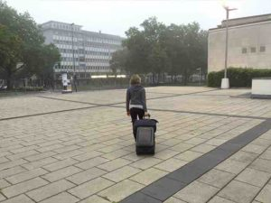 carol hauling luggage to train station